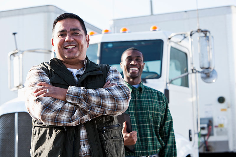 two truckers standing outside