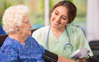young female medical professional assisting and older woman