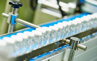 vials on a conveyer belt